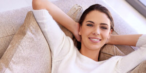 woman relaxed on couch